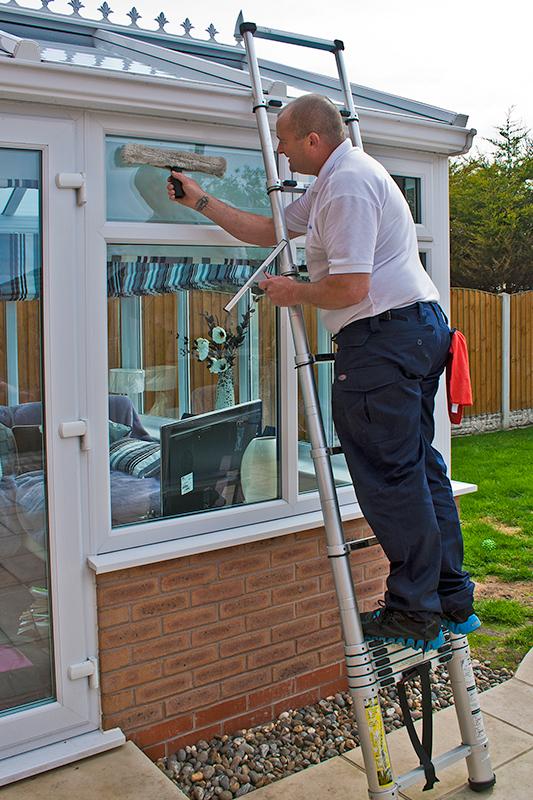 Man cleaning windows image